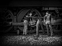 """Here's the Problem"" Three men repairing a Steam Engine"